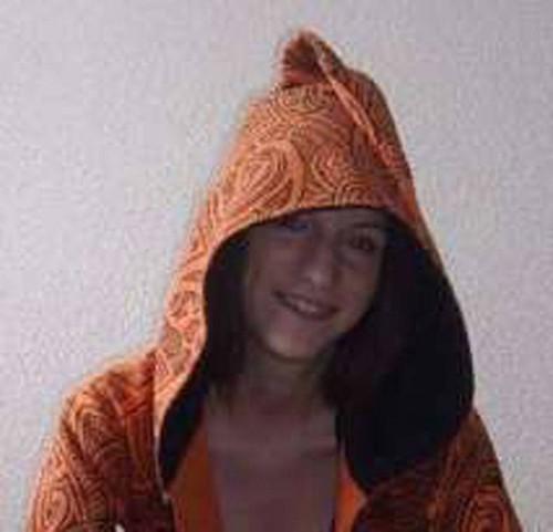 customer wearing orange fullprint jacket